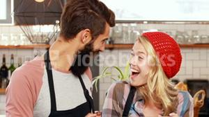 Hipster couple holding open sign