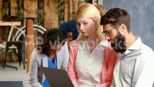 Hipster business people using laptop
