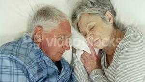 Senior couple sleeping in bed