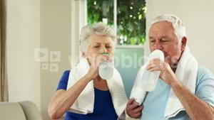 Senior couple drinking water