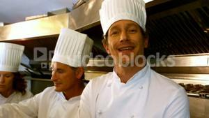 Smiling chef with arms crossed