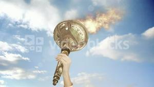 Close up of feminine hand holding Olympic torch