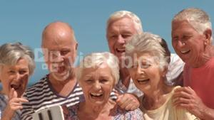 Group of mature people taking a photo