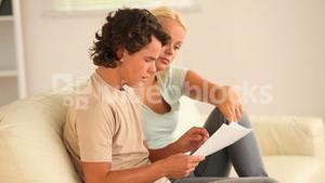 Worried couple looking at a document