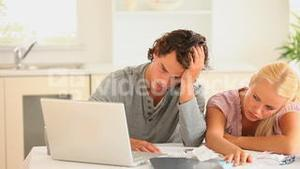 Sad couple checking at their account