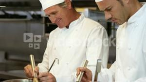 Two chef preparing a meal