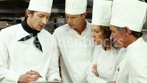 Team of chef preparing the service
