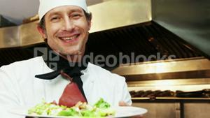 Chef holding a plate with food