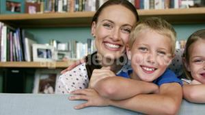 Portrait of a cute family posing and smiling