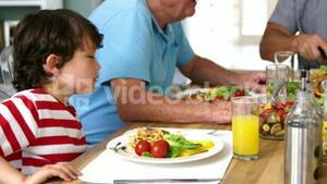 Cute family eating together