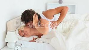 Unhappy couple lying in their bed