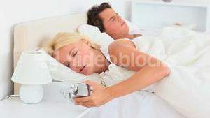 Sleeping couple not wanting to wake up