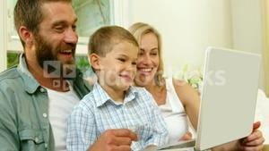 Parent and his son looking at tablet computer