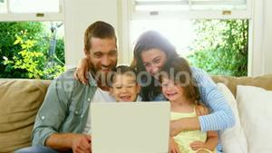 Family looking at the tablet computer