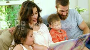 Family reading a children book