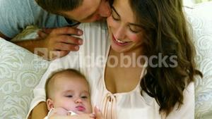 Happy parents with their baby