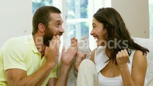 Excited couple making triouph gesture