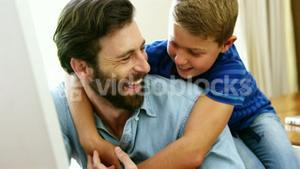 Happy father and son holding each other