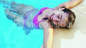Pretty woman relaxing on pool