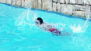 Child swimming with a red swimwear