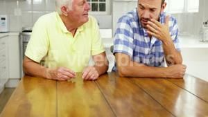 Mature man and man talking together