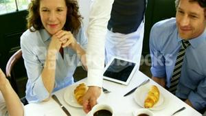 Business people being served