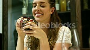 Business woman eating a desert