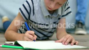 A child drawing and coloring