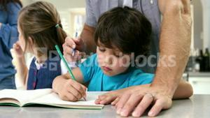 A father coloring with his son