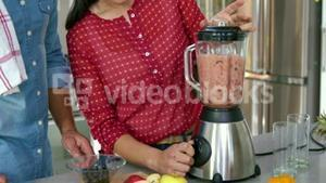 Couple making smoothies