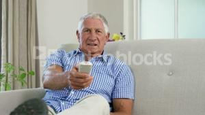Old man using remote controller