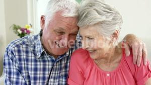 Loving old couple on the couch