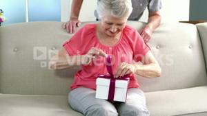 Old woman opening her gift