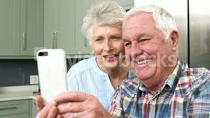 Smiling old people taking a selfie