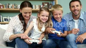 A happy family is playing video games