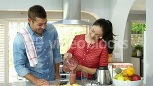 A couple is making smoothies