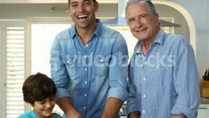 multi generation men of the family are cooking