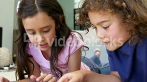 Two children are playing video games