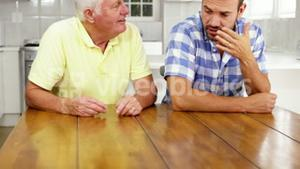 Nervous discussion between a son and his father