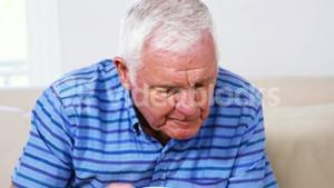 Mature man reading his newspaper and drinking his newspaper