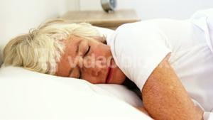 Senior woman suffering in her bed