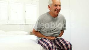 Senior man suffering in his bed