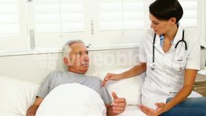 Home nurse speaking with elderly patient