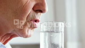 Senior man drinking a water glass