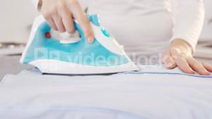 Close up on a woman doing the ironing