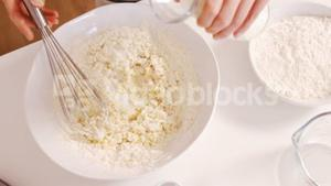 Woman baking with flour and milk