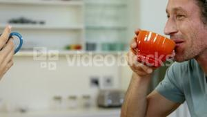Couple cheering with a hot beverage