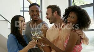 Friends cheering with white wine