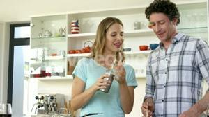 Mature couple smiling and cooking together