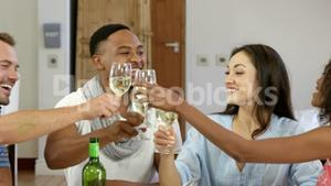 Multi-ethnic friends eating together